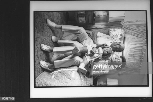 Fred Mildred Kassab parents of murder victim Colette MacDonald sit on bed holding one of her blonde girl baby dolls as they mourn her death at the...