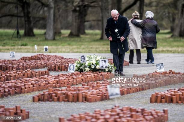 Fred Mouw lays flowers on the grounds of the memorial centre during the commemoration of 76 years since the liberation of the Westerbork nazi camp in...