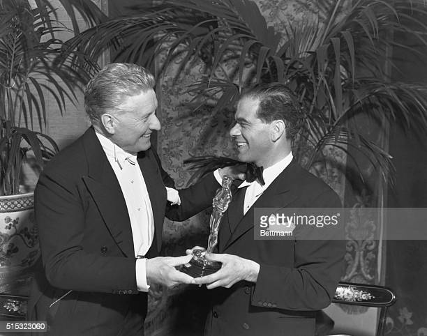 Fred Niblo presents director Frank Capra with his Academy Award for 1938's You Can't Take it with You