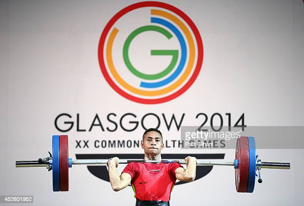 Fred Oala of Papua New Guinea competes in the Men's 56Kg Group B Weightlifting at the Scottish Exhibition And Conference Centre during day one of the...