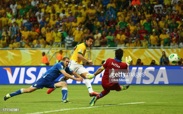 Fred of Brazil beats Giorgio Chiellini and Gianluigi Buffon of Italy to score their third goal during the FIFA Confederations Cup Brazil 2013 Group A...