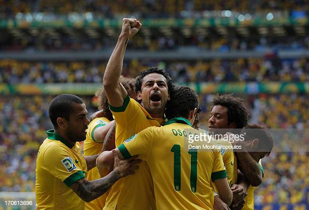 Fred of Brazil celebrates after Neymar scored his team's opening goal during the FIFA Confederations Cup Brazil 2013 Group A match between Brazil and...