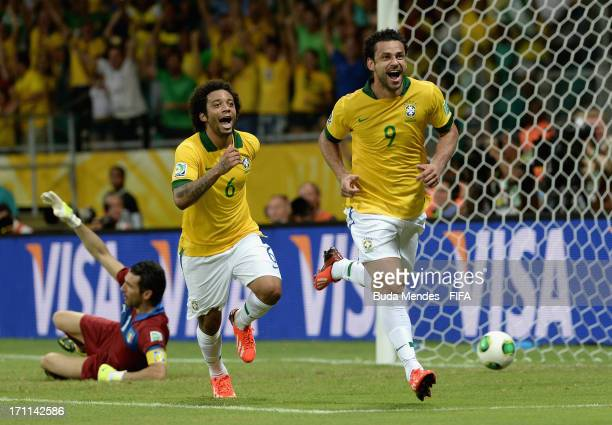 Fred of Brazil celebrates with team mate Marcelo as he scores their fourth goal during the FIFA Confederations Cup Brazil 2013 Group A match between...