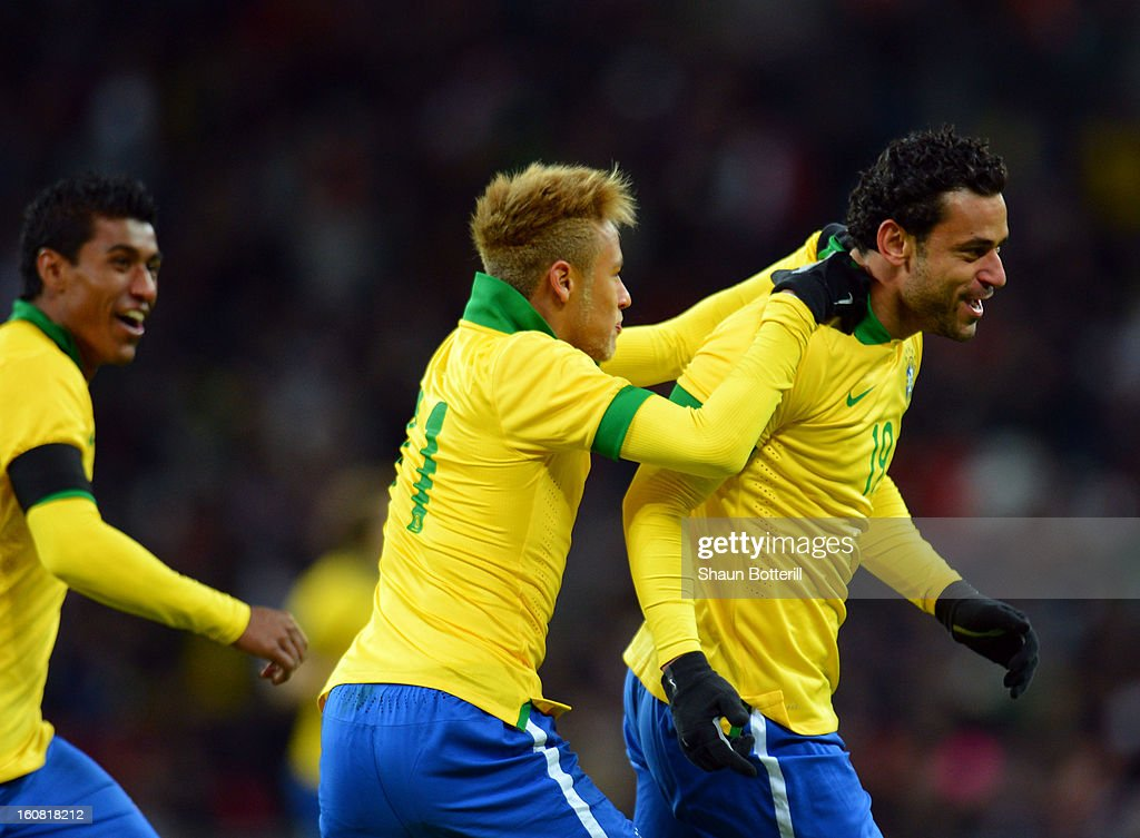Fred of Brazil (R) celebrates with team-mate Neymar of Brazil after scoring the equalising goal during the International friendly between England and Brazil at Wembley Stadium on February 6, 2013 in London, England.