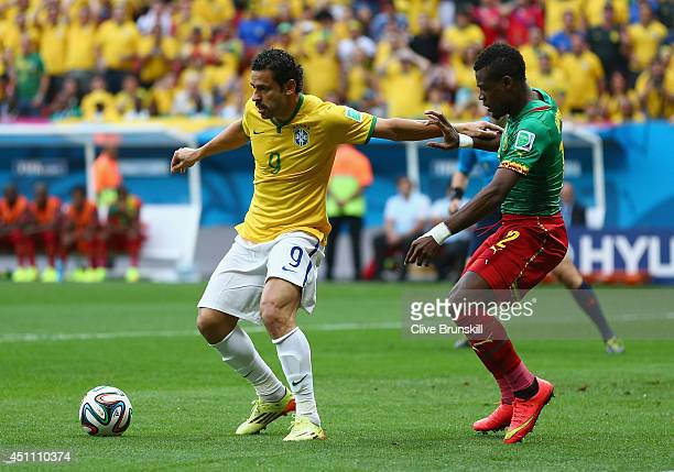 Fred of Brazil controls the ball against Henri Bedimo of Cameroon during the 2014 FIFA World Cup Brazil Group A match between Cameroon and Brazil at...
