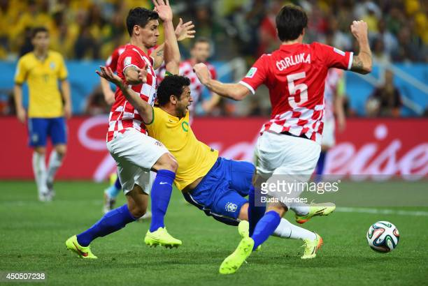 Fred of Brazil falls to the field in the box against Dejan Lovren of Croatia in the second half during the 2014 FIFA World Cup Brazil Group A match...