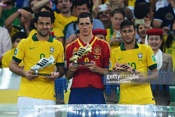 Fred of Brazil holds the Silver Boot award Fernando Torres of Spain holds the adidas Golden Boot award and Neymar of Brazil holds the Bronze Boot...