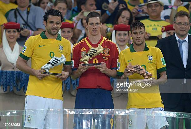 Fred of Brazil poses with the adidas Silver boot Fernando Torres of Spain the adidas Golden boot and Neymar of Brazil the adidas Bronze boot after...