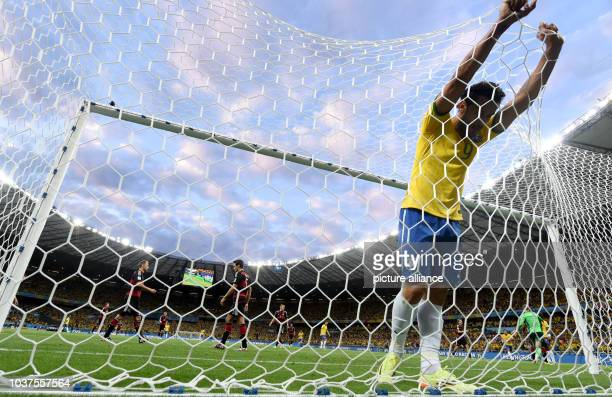 Fred of Brazil reacts during the FIFA World Cup 2014 semi-final soccer match between Brazil and Germany at Estadio Mineirao in Belo Horizonte,...