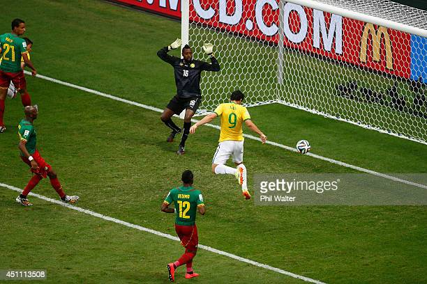 Fred of Brazil scores his team's third goal on a header past Charles Itandje of Cameroon during the 2014 FIFA World Cup Brazil Group A match between...