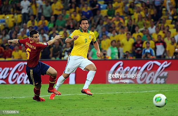 Fred of Brazil scores his team's third goal to make the score 30 during the FIFA Confederations Cup Brazil 2013 Final match between Brazil and Spain...