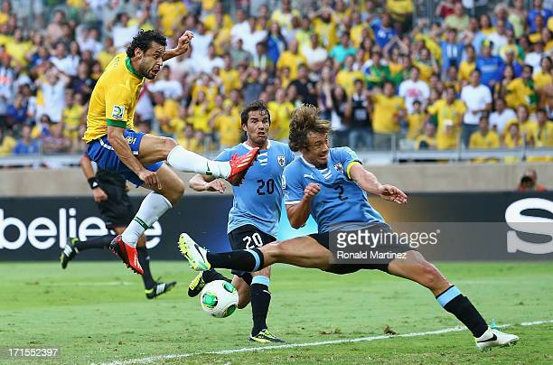 Fred of Brazil scores the opening goal during the FIFA Confederations Cup Brazil 2013 Semi Final match between Brazil and Uruguay at Governador...