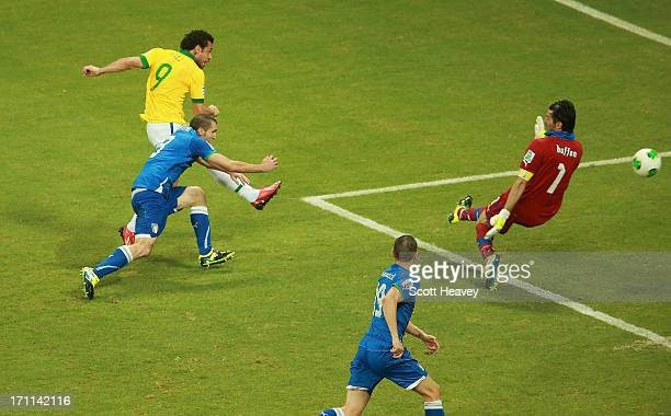 Fred of Brazil scores their third goal past goalkeeper Gianluigi Buffon of Italy during the FIFA Confederations Cup Brazil 2013 Group A match between...