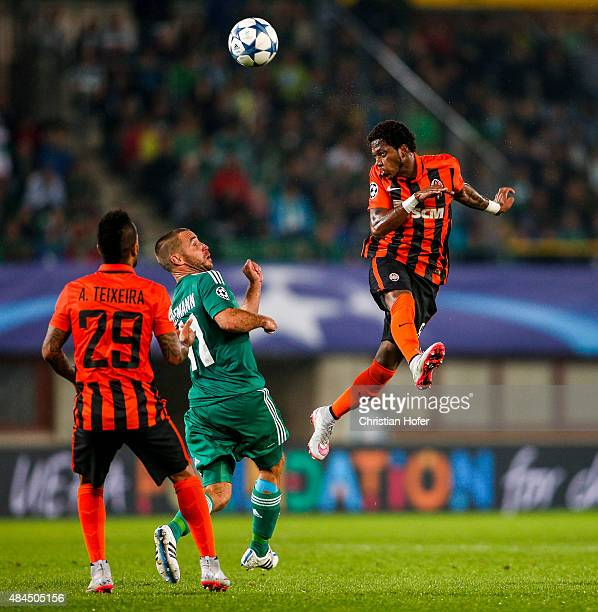 Fred of Donetsk competes for the ball in the air with Steffen Hofmann of Vienna during the UEFA Champions League Qualifying Round Play Off First Leg...