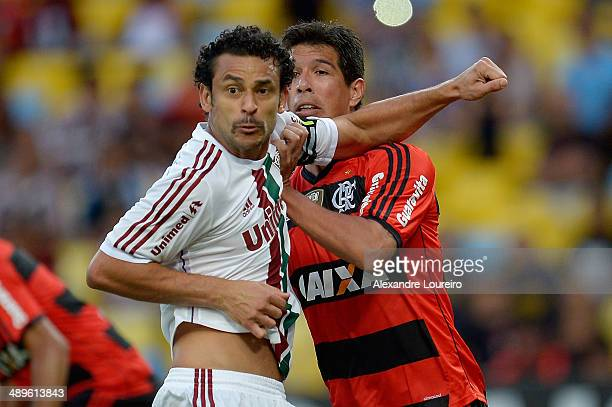Fred of Fluminense battle with Caceres of Flamengo during the match between Fluminense and Flamengo as part of Brasileirao Series A 2014 at Maracana...