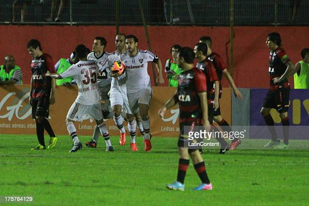 Fred of Fluminense celebrates a goal with his teammates during a match between Fluminense and Vitoria as part of the Brazilian Serie A 2013 on August...