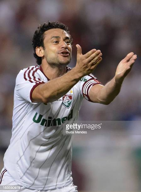 Fred of Fluminense celebrates a scored goal against Botafogo during a match as part of Serie A 2012 at Engenhao stadium on October 06, 2012 in Rio de...