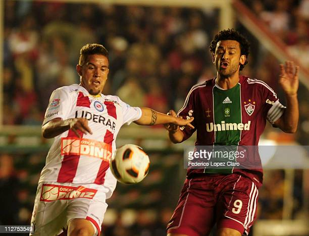 Fred of Fluminense fights for the ball with Prosperi of Argentinos Jr in a match for the Santander Libertadores Cup 2011 in Diego Armando Maradona...