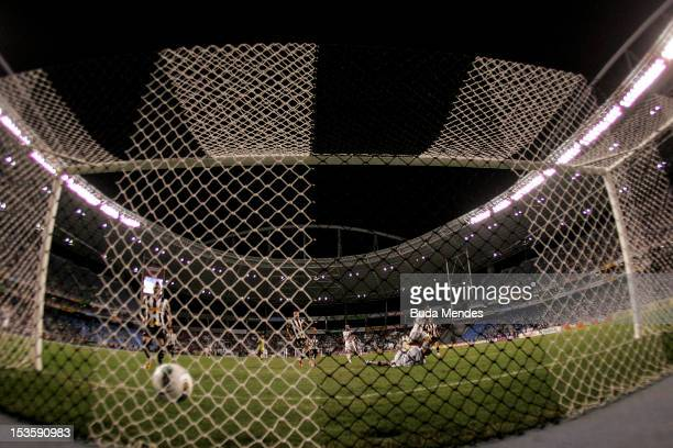 Fred of Fluminense shoots to score against Botafogo during a match as part of Serie A 2012 at Engenhao stadium on October 06, 2012 in Rio de Janeiro,...