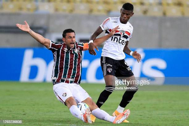 Fred of Fluminense struggles for the ball with Arboleda of Sao Paulo during a match between Fluminense and Sao Paulo as part of 2020 Brasileirao...