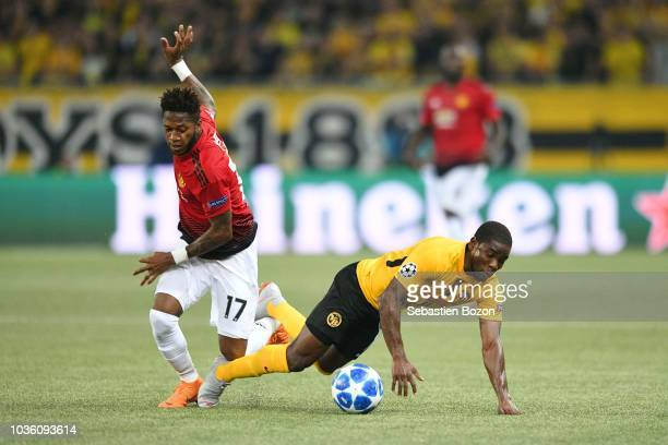 Fred of Manchester and Roger Assale of Bern during the Champions League match between Young Boys Bern and Manchester United at Stade de Suisse...