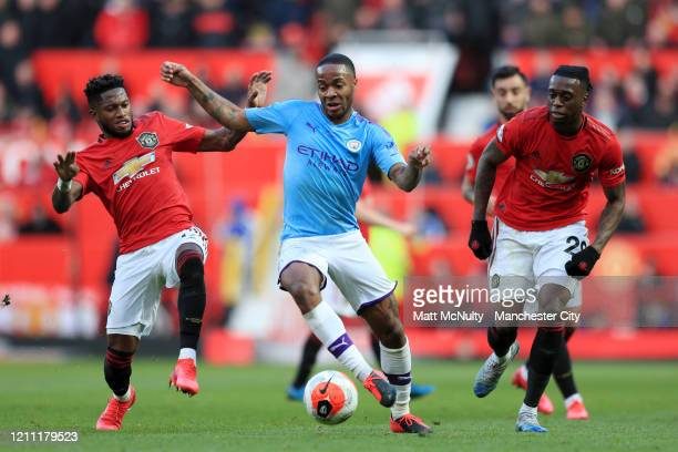 Fred of Manchester United and Aaron WanBissaka of Manchester United battles for possession with Raheem Sterling of Manchester City during the Premier...