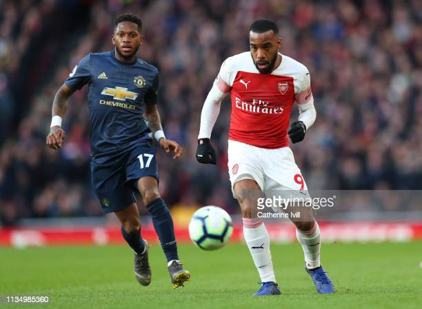 Fred of Manchester United and Alexandre Lacazette of Arsenal during the Premier League match between Arsenal FC and Manchester United at Emirates...