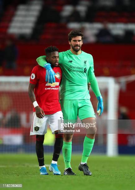 Fred of Manchester United and Alisson Becker of Liverpool embrace at the final whistle during the Premier League match between Manchester United and...