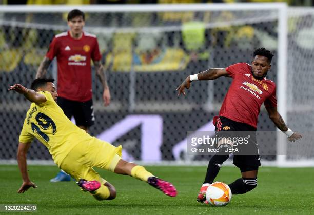 Fred of Manchester United and Francis Coquelin of Villarreal CF stretch for the ball during the UEFA Europa League Final between Villarreal CF and...