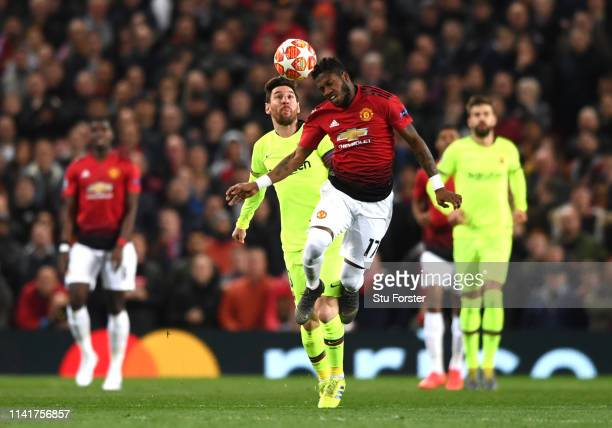 Fred of Manchester United and Lionel Messi of Barcelona clash during the UEFA Champions League Quarter Final first leg match between Manchester...