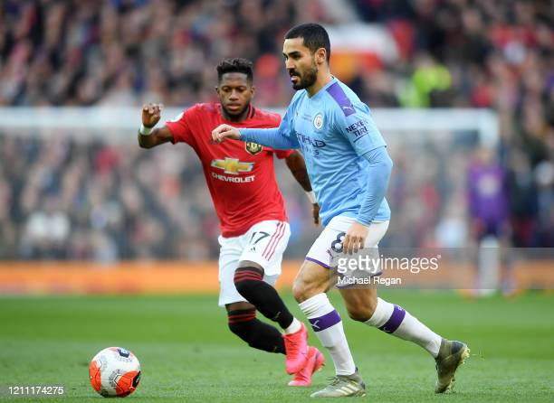 Fred of Manchester United battles for possession with Ilkay Gundogan of Manchester City during the Premier League match between Manchester United and...