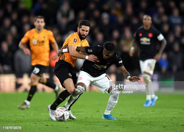 Fred of Manchester United battles for possession with Joao Moutinho of Wolverhampton Wanderers during the FA Cup Third Round match between...