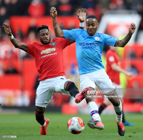 Fred of Manchester United battles for possession with Raheem Sterling of Manchester City during the Premier League match between Manchester United...