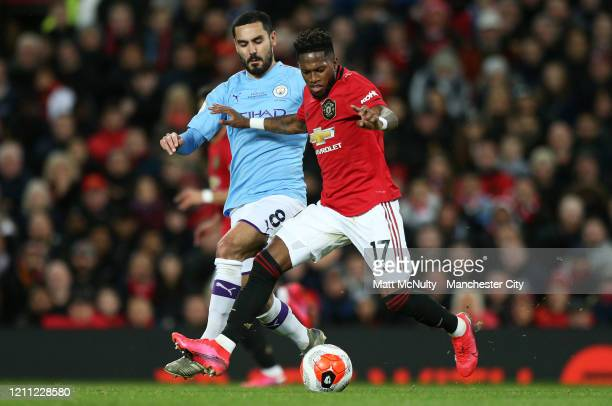 Fred of Manchester United battles with Ilkay Gundogan of Manchester City during the Premier League match between Manchester United and Manchester...