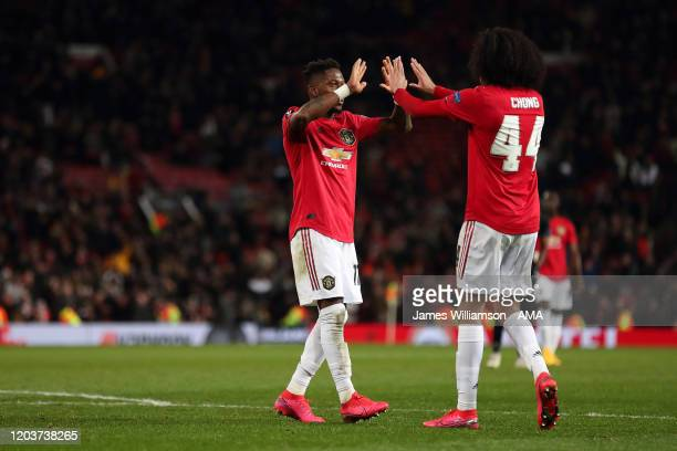 Fred of Manchester United celebrates after scoring a goal to make it 5-0 with Tahith Chong during the UEFA Europa League round of 32 second leg match...
