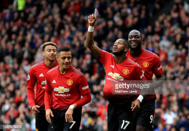 Fred of Manchester United celebrates after scoring his teams first goal with his team mates during the Premier League match between Manchester United...
