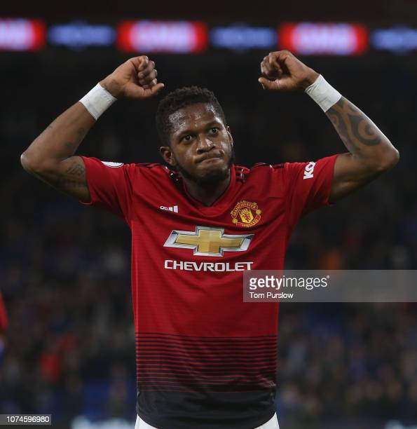 Fred of Manchester United celebrates Jesse Lingard scoring their fifth goal during the Premier League match between Cardiff City and Manchester...