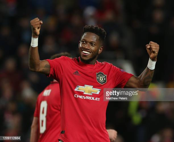 Fred of Manchester United celebrates scoring their fifth goal during the UEFA Europa League round of 32 second leg match between Manchester United...