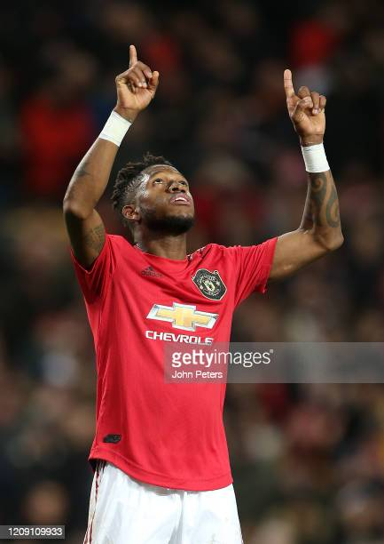 Fred of Manchester United celebrates scoring their fourth goal during the UEFA Europa League round of 32 second leg match between Manchester United...