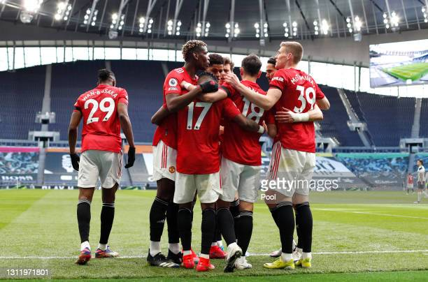Fred of Manchester United celebrates with Paul Pogba, Bruno Fernandes and Scott McTominay after scoring their team's first goal during the Premier...
