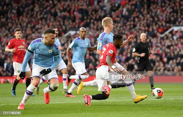 Fred of Manchester United falls to the gorund as he collides with Oleksandr Zinchenko of Manchester City during the Premier League match between...