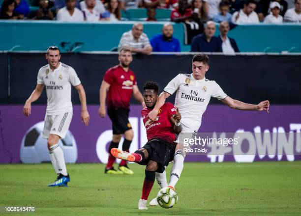Fred of Manchester United gets tripped up during the International Champions Cup match against Real Madrid at Hard Rock Stadium on July 31 2018 in...
