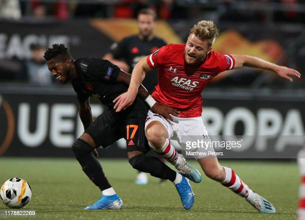 Fred of Manchester United in action with Fredrik Midtsjo of AZ Alkmaar during the UEFA Europa League group L match between AZ Alkmaar and Manchester...
