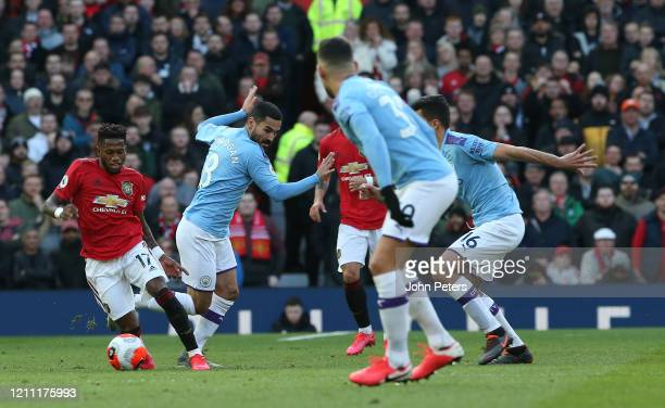 Fred of Manchester United in action with Ilkay Gundogan of Manchester City during the Premier League match between Manchester United and Manchester...