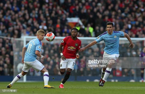 Fred of Manchester United in action with Oleksandr Zinchenko and Rodrigo of Manchester City during the Premier League match between Manchester United...
