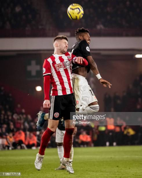 Fred of Manchester United in action with Oliver Norwood of Sheffield United during the Premier League match between Sheffield United and Manchester...