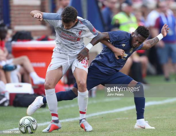 Fred of Manchester United in action with Pedro Chrivella of Liverpool during the preseason friendly match between Manchester United and Liverpool at...