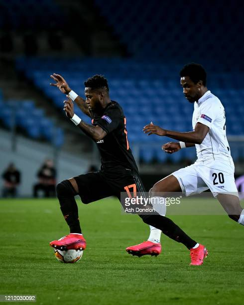 Fred of Manchester United in action with Samuel Tetteh of LASK during the UEFA Europa League round of 16 first leg match between LASK and Manchester...