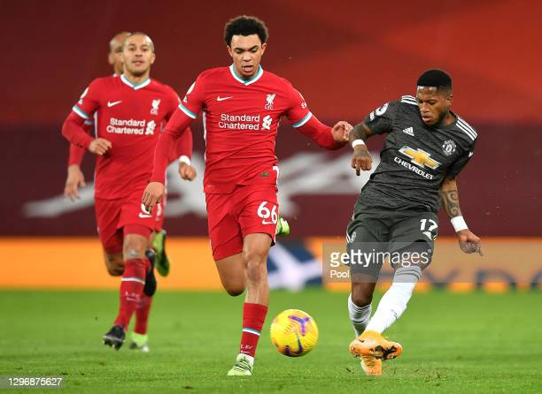 Fred of Manchester United is challenged by Trent Alexander-Arnold of Liverpool during the Premier League match between Liverpool and Manchester...