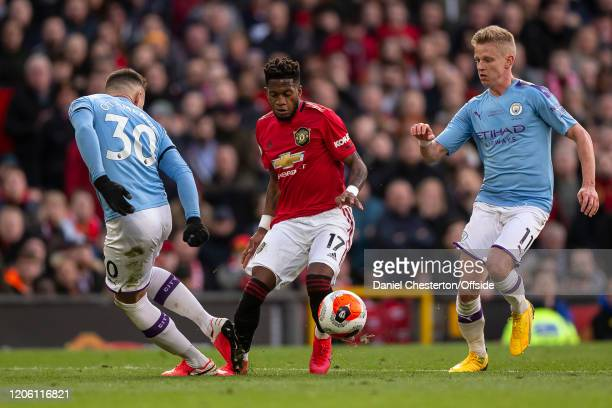 Fred of Manchester United is tackled by Nicolas Otamendi of Manchester City and subsequently receives a yellow card for diving during the Premier...
